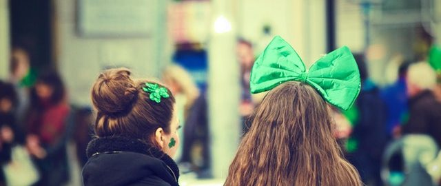 girls wearing festive green st. paddy's day bows and hair ties.
